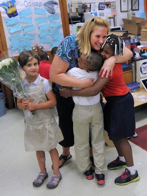 IPS teacher Ann Mennonno (shown here with students  Warren Sweat and Raven Hickenbottom and daughter Eva Mennonno) was among four teachers who won the Hubbard Life-Changing Teacher Award last year.
