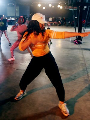 Felisia Newby, owner of Lifestyle Fitness Gold and Lifestyle Cafe in Eastpointe, was one of the fitness instructors who donated time and money toward a fund-raiser for the Burrell brothers' funeral expenses and medical costs on Sunday at Bert's Warehouse Theatre in Detroit.