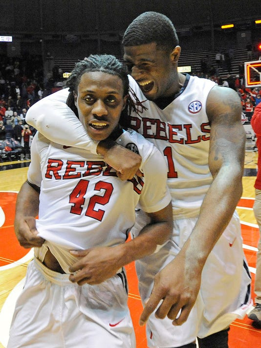Mississippi guard Martavious Newby (1) celebrates with guard Stefan Moody after an NCAA college basketball game against Texas A&M in Oxford, Miss., Wednesday, Feb. 4, 2015. Mississippi won 69-59. (AP Photo/The Daily Mississippian, Thomas Graning)