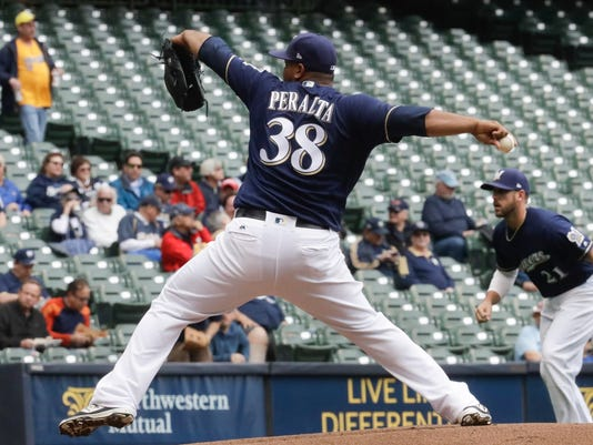Milwaukee Brewers' Wily Peralta throws during the first inning of a baseball game against the Cincinnati Reds Wednesday, April 26, 2017, in Milwaukee. (AP Photo/Morry Gash)