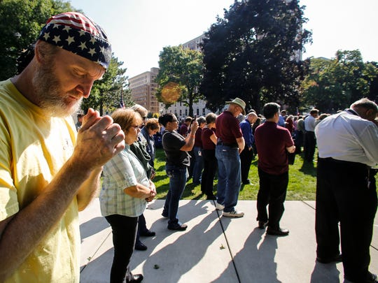 About 8,100 people, including Rick Holey of Lansing attended a prayer rally at the State Capitol October 4, 2016, to pray and listen to Franklin Graham's evangelical Christian message as part of Graham's Decision America Tour.
