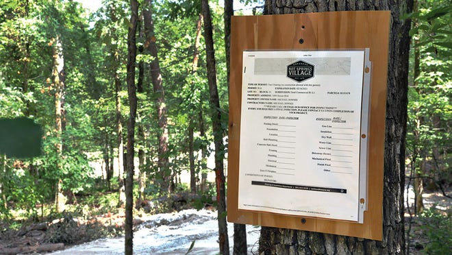 Commercial site with tree-clearing permit will have rental storage units.