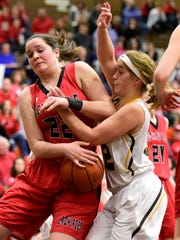 Old Fort's Jordan Magers, left, and Hicksville's Addison Bergman fight over the ball during the Div. IV regional semifinal in Elida.