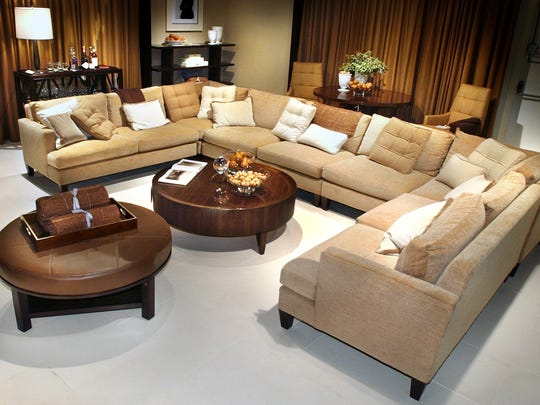 """The 2005 International Home Furnishings Show in North Carolina featured a media room designed by Barbara Barry with the focal point of the masculine arrangement being a large """"casting couch."""""""