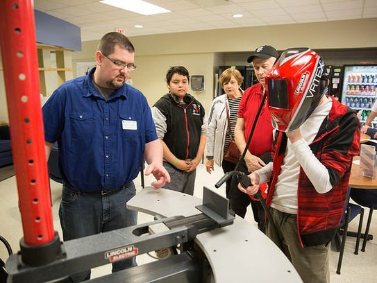 Community members tried out a virtual welder during