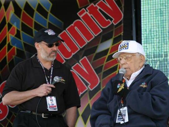 Pat Sullivan (left) with Tom Carnegie at Indianapolis