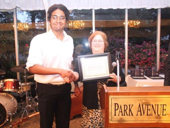 Scholarship recipient Matthew accepts the Lisa Warren