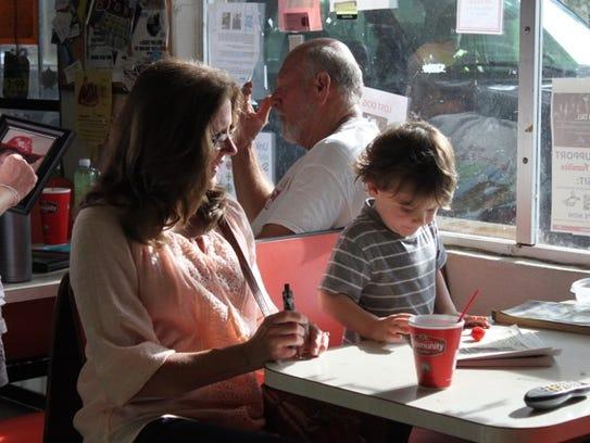 Customers enjoy morning coffee at Glenda's Country