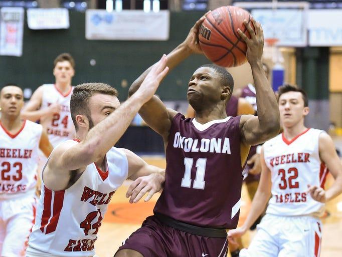 Okolona's Jacorrius Stanfield (11) looks to shoot against
