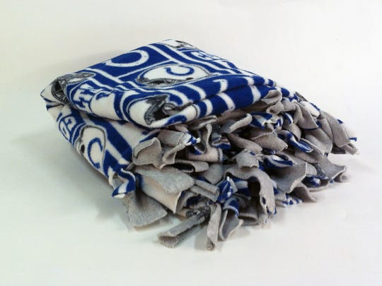 Have some time? Make this DIY fleece blanket for your Colts fan.