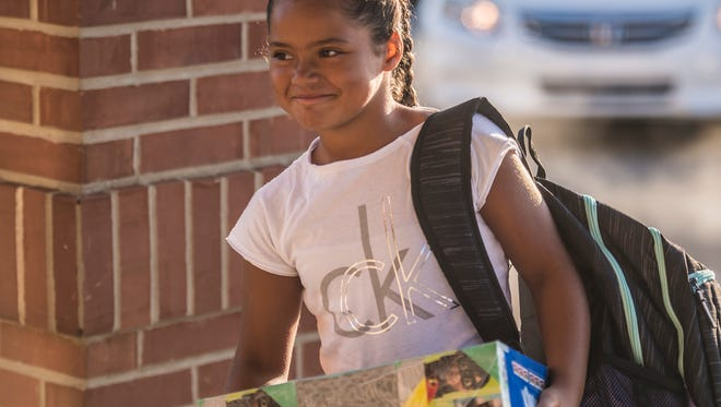 Children arrived early for their first day of school at Fairview Elementary on Wednesday, Aug. 9, 2017 in Richmond, Ind.