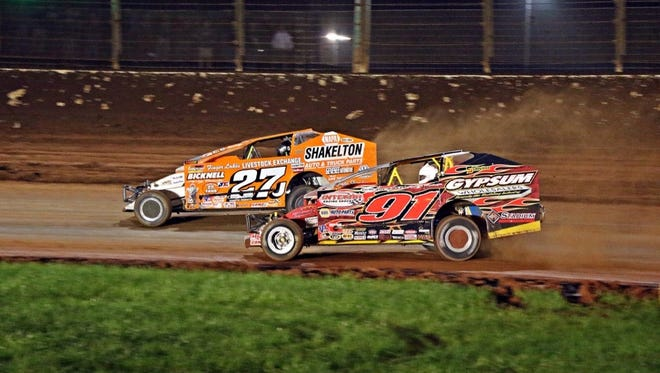 Danny Johnson (27) battles Billy Decker (91) for the lead in the Big Block Modified race in Charlotte last weekend.