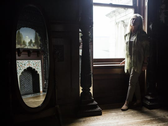Sandi Dulaney, wife of the majority shareholder for Swannanoa, stands for a portrait inside the palace on Sept. 10, 2015.