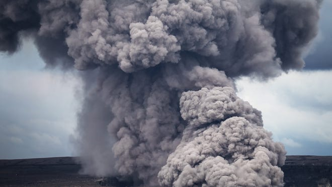 An ash plume rises from the Halemaumau crater within the Kilauea volcano on May 9, 2018, in Hawaii.