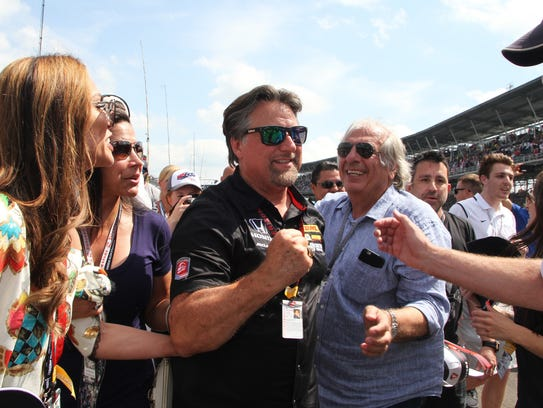 Car owner Michael Andretti celebrates after Takuma