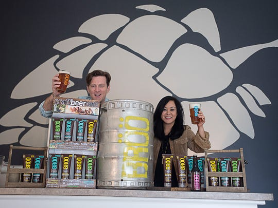 Brad and Sarah Pearsall  raise a glass of beer Feb.