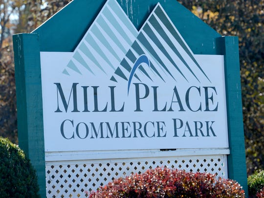 A sign marks the entrance to Mill Place Commerce Park