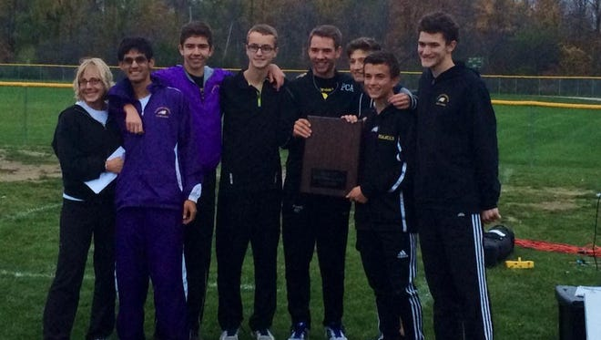 Celebrating Plymouth Christian's MIAC cross country championship are (from left) head coach Jennifer Lemieux, Gareth Matson, Phillip Morby, Ian Hay, Joey Fanelli, Ben Fuller, Seth Windle and Paul Chamberlain.