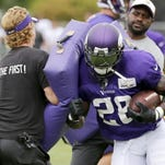 Minnesota Vikings running back Adrian Peterson participates in practice at an NFL football training camp on the campus of Minnesota State University Tuesday, July 28, 2015, in Mankato, Minn.