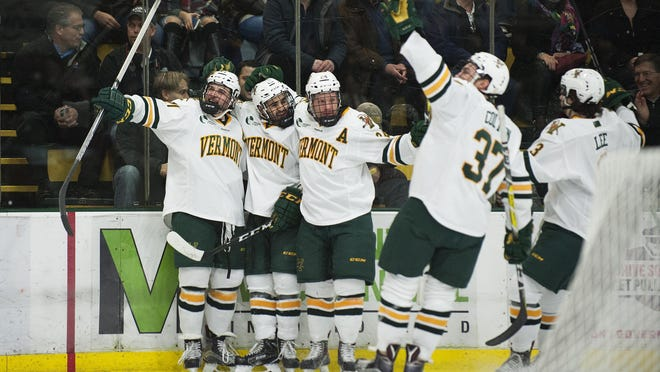 Vermont celebrates a goal during the men's hockey game between the UConn Huskies and the Vermont Catamounts at Gutterson Fieldhouse last season.