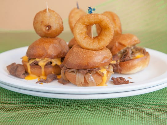 Cheesesteak sliders with whiz are displayed at the