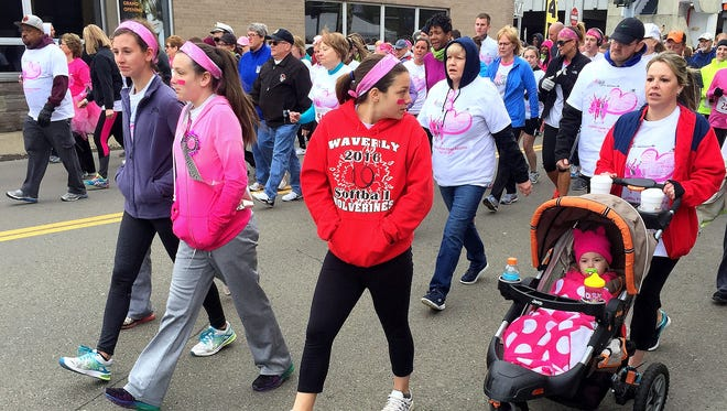 Walkers take part in Sunday's  18th annual Komen Twin Tiers Race for the Cure in downtown Elmira.