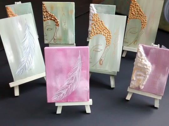 Hannah Manner's tiny paintings come with their own easels for displaying.