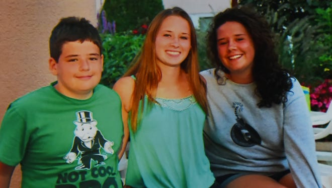 Copy photo of Andrew Gutierrez, a SBHS 10th grader, who suddenly and unexpectedly passed away at home on Friday, February 16th, taken with his two sisters Jackie (C) and Emily (R).