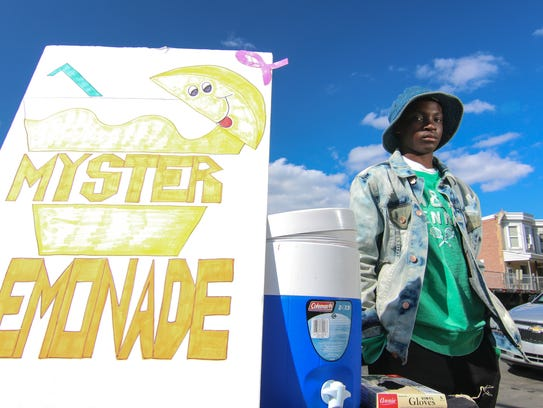 Nasai Oliver, 12, sells lemonade at his stand back