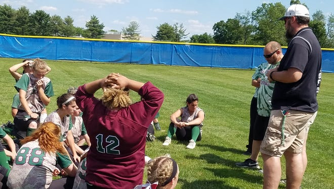 Cedar Creek softball coach Shawn Cohen, right, speaks to his Pirates after a 10-0 loss to Robbinsville in Thursday's Group 2 semifinals.