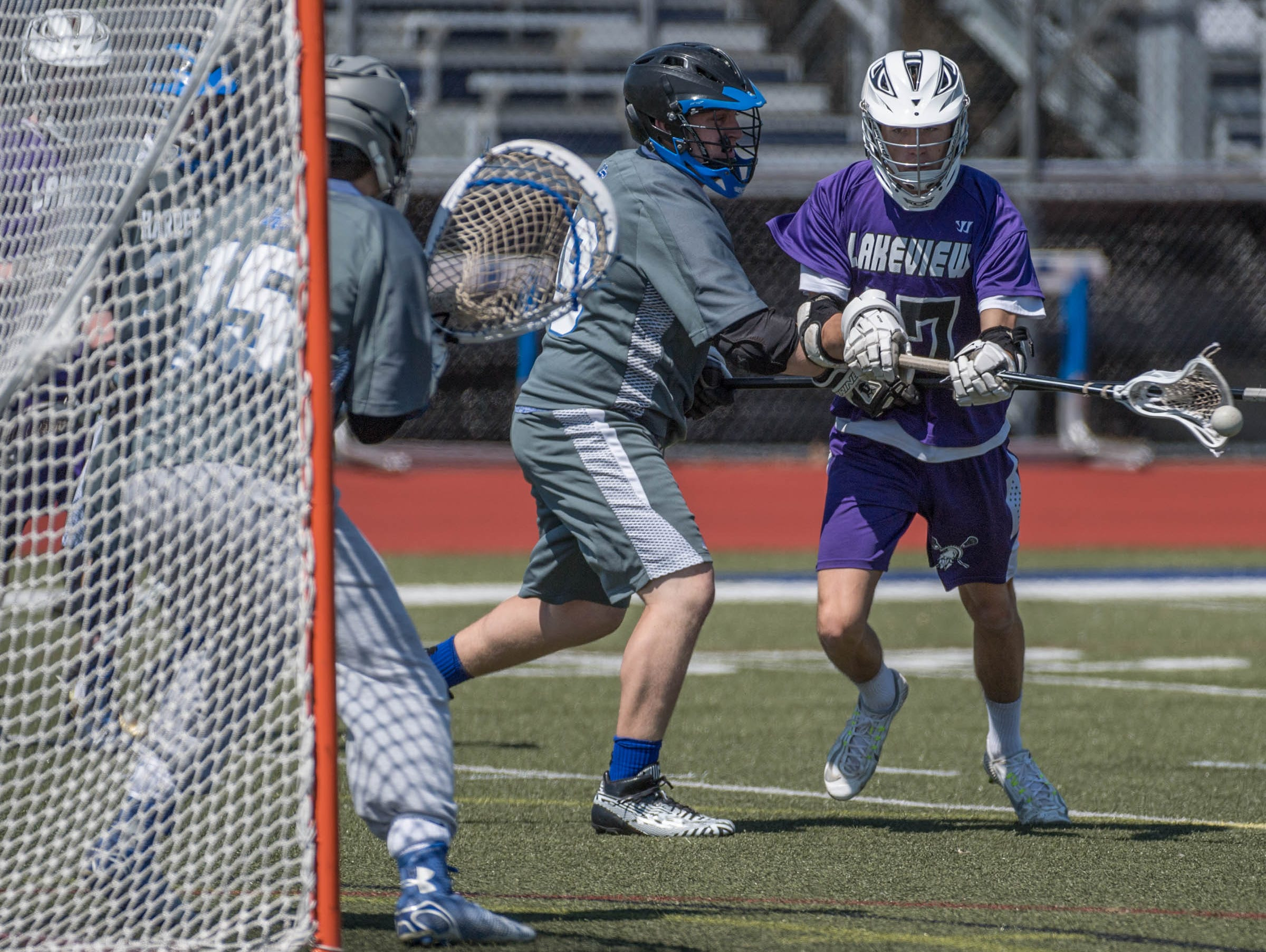 Lakeview's Peyton Perry (17) takes a shot on goal against Harper Creek in the All City Lacrosse Tournament on Saturday.