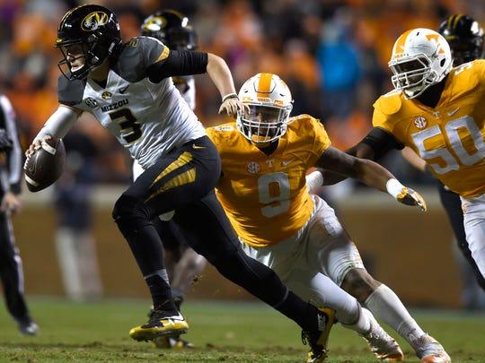 Tennessee defensive end Derek Barnett chases down Missouri quarterback Drew Lock during the second half at Neyland Stadium on Saturday, Nov. 19.