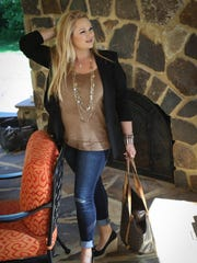 Nicole Drescher wears a blazer and distressed jeans from WHBM with faux suede top from a Jersey Shore boutique.
