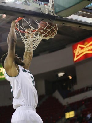 Jamar Hurdle goes in for a dunk in the second half of UWGB's win over Cleveland State.