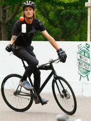 A bike polo player juggles the ball during practice