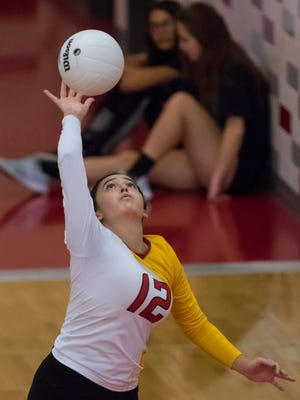 Centennial setter Raquel Gonzalez serves for the Hawks during the championship game of the Jane Leupold Sweet 16 volleyball tournament on Saturday.