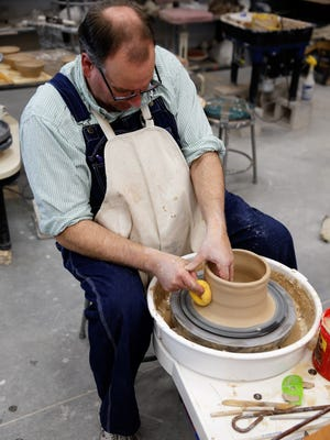 Bill Barnes, a San Juan College ceramics student from Farmington, shapes a piece for the annual Charity Bowl Sale on the college campus in Farmington. The two-day event opens Thursday at the college.