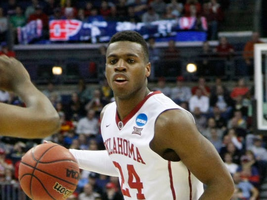 Oklahoma Sooners guard Buddy Hield (24) is guarded by Dayton Flyers forward Dyshawn Pierre (21) during the first half in the third round of the 2015 NCAA Tournament at Nationwide Arena.