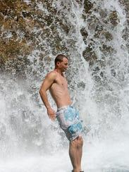 Joe Wallis, 27, of Prescott, jumps from the top of