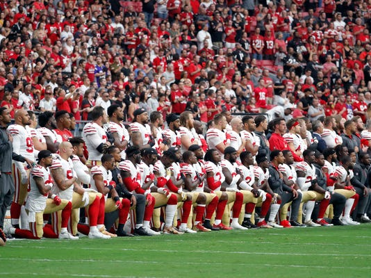 Members of the San Francisco 49ers kneel during the national anthem as others stand during the first half of an NFL football game against the Arizona Cardinals, Sunday, Oct. 1, 2017, in Glendale, Ariz. (AP Photo/Rick Scuteri)