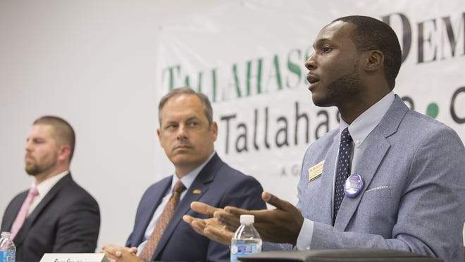 Bruce Strouble answers a question during a meeting of the Tallahassee Democrat Editorial Board on July 12. Strouble is challenging incumbent Tallahassee City Commissioner Scott Maddox, center, and Luther Lee, left, for Seat 1 on the commission.