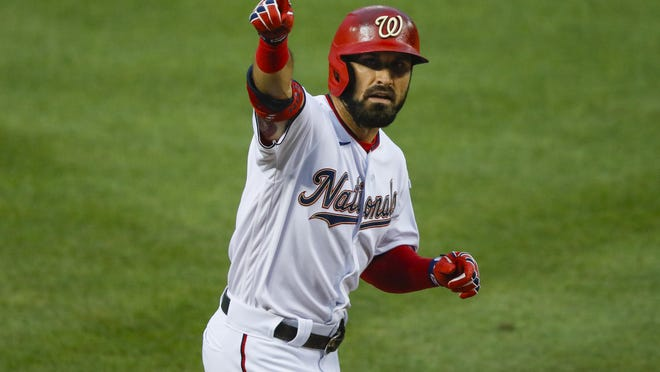 Washington Nationals Adam Eaton celebrates his solo homer against the New York Yankees during the first inning of an opening day baseball game at Nationals Park, Thursday, July 23, 2020, in Washington.