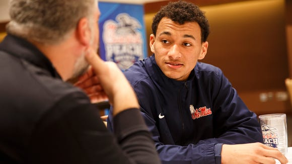 Ole Miss tight end Evan Engram talks to reporters during a press conference before the Peach Bowl.