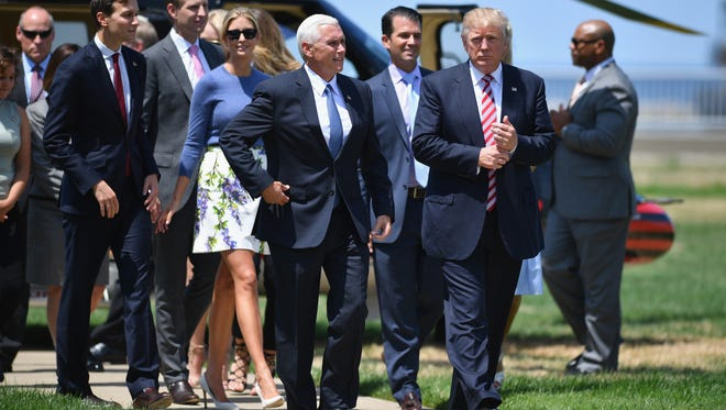 Donald Trump and his family attend a welcome arrival event with Mike Pence and his family at the Great Lakes Science Centre on July 20, 2016, in Cleveland.