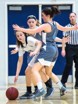 Burlington's Ella Decelles, left, dribbles around South Burlington's Joan Vera in Burlington on Tuesday, February 20, 2018.