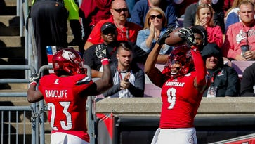 Louisville's Jaylen Smith (#9) and Brandon Radcliff celebrate after Smith scores a touchdown.  Oct. 22, 2016