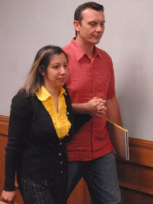 Leilani and Dale Neumann enter Marathon County Circuit Court in 2008. Leilani is serving the first month of her six month sentence at Marathon County Jail.