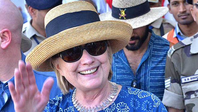 This photo taken on March 13, 2018 shows former secretary of state Hillary Clinton waving as she arrives in Jodhpur in the western Indian state of Rajasthan.