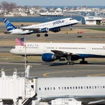 JetBlue, Delta and American planes at Boston's Logan International Airport on April 13, 2015.