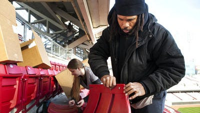Charlie Ford and Shonna Delaney work on installing new seats at Great American Ball Park on Monday, December 15, 2014. The crew started in left field and worked their way to home plate. The project was slated to be completed in 16 weeks, but due to weather it may take longer.